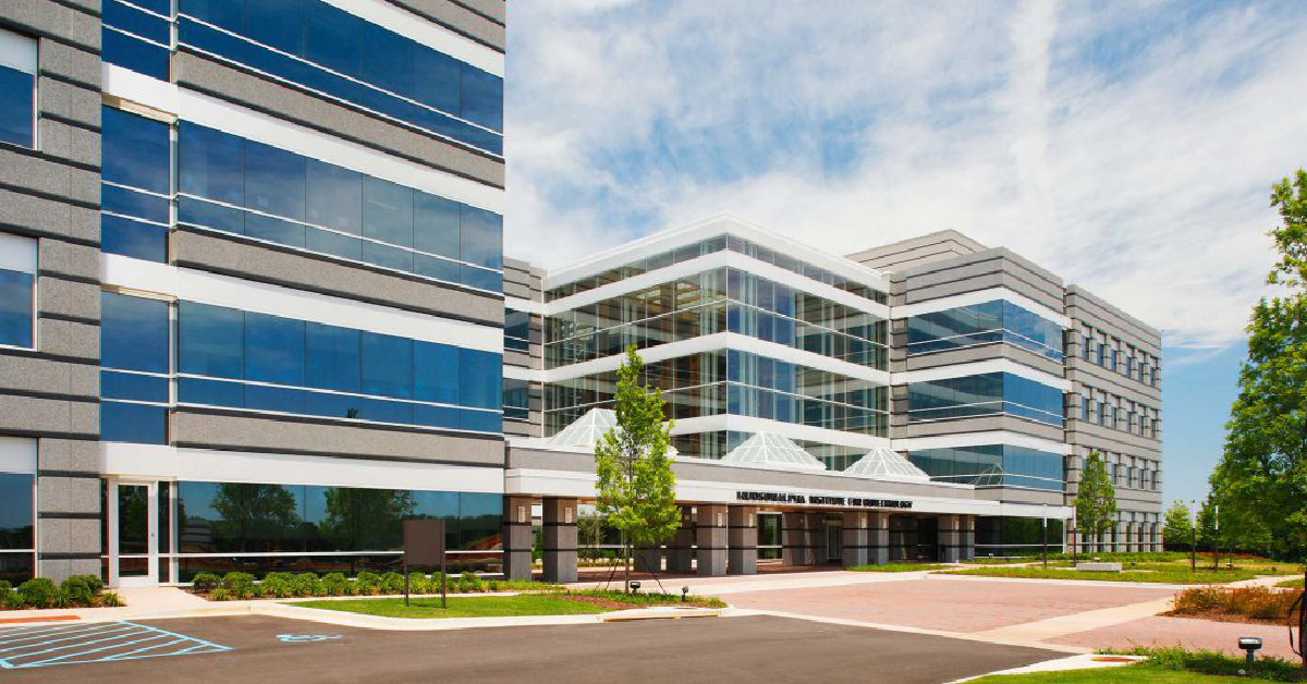 White, beige, and blue glass, 4-5 story office building where iRepertoire is housed on the Hudson Alpha campus in Huntsville, Alabama